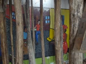 Beautiful artwork masked by wooden sticks
